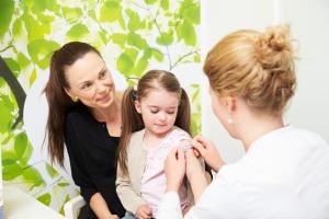 Parent vaccinating child