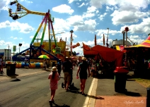 People head to the amusement rides at the Canberra Show