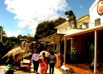Family walks into the Dinosaur Museum, Canberra