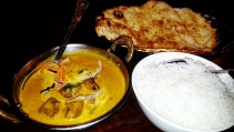 Lamb korma, garlic naan and rice at the Garnish of India, Canberra