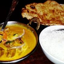Lamb korma, garlic naan and rice at the Garnish of India, Canberra