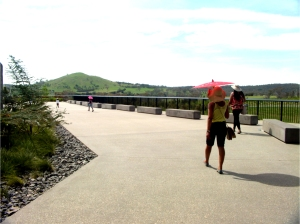 Women with sun umbrellas at the National Arboretum Canberra