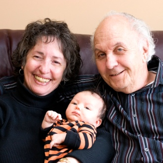 Two grandparents hold a baby