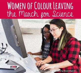 Two women of colour work together on a computer
