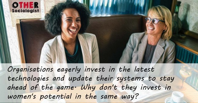 A Black woman and a White women dressed in suits sit together laughing. Text reads: Organisations eagerly invest in the latest technologies and update their systems to stay ahead of the game. Why don't they invest in women's potential in the same way?