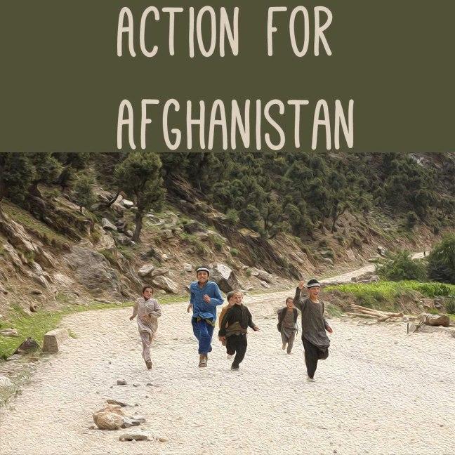 Children run down a dirt road in Afghanistan