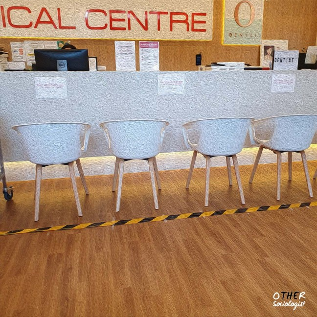 Medical centre with chairs and police tape blocking off front desk