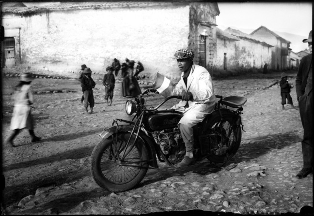 Quechuan man rides a bike in the 1900s