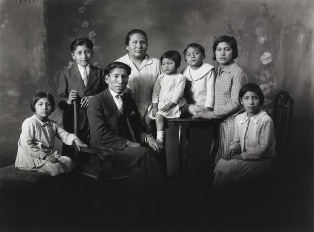 Quechuan family sit for a portrait
