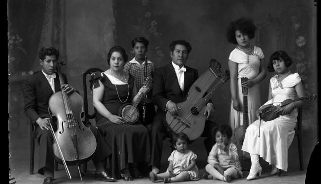 Quechuan muscians from early 1900s, dressed in fancy clothes