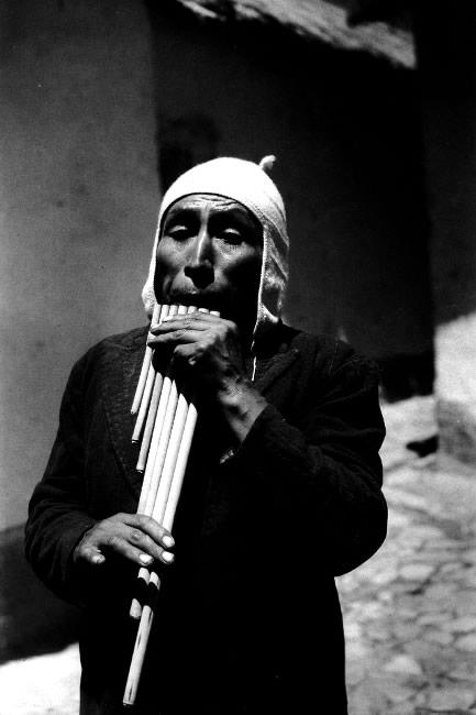 Quechuan man plays the siku