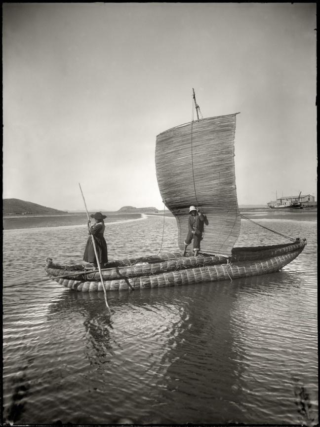 Quechuan people steer a boat