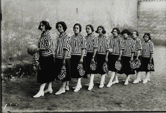 Quechuan women dressed in sports uniform from early 1920s. One of them holds a futbal